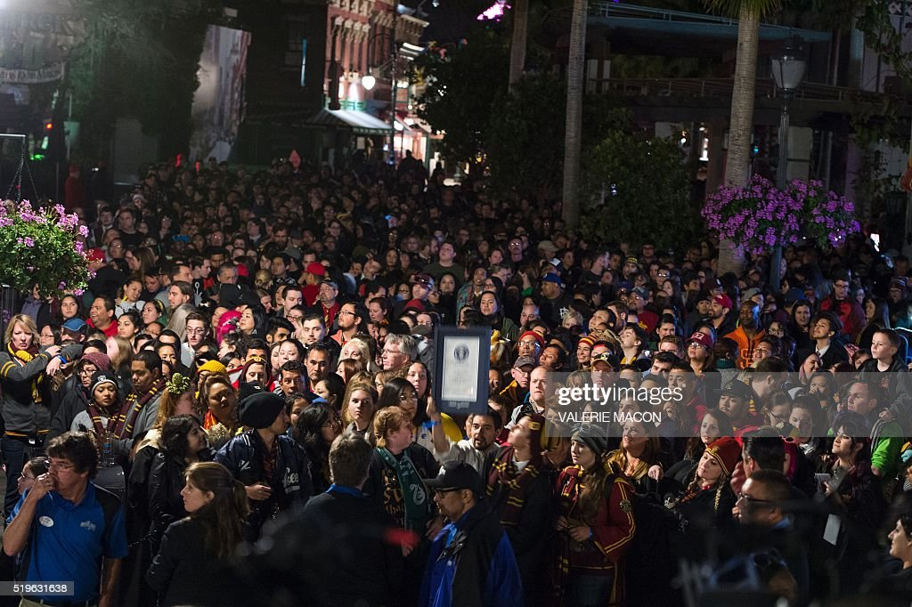 Fans wait to get in Hogsmeade at the Grand Opening to the public of the 'Wizarding World of Harry Potter' at Universal Studios Hollywood, in Universal City, California, on April 7, 2016. Fifteen years after Harry Potter's first big screen adventure, Universal is enchanting a new generation of Muggles with its most spectacular conjuring trick yet -- a theme park in the heart of Hollywood. / AFP / VALERIE