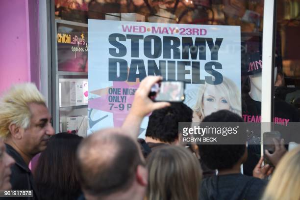 FanS wait to meet adult film star Stormy Daniels at Chi Chi Larue's adult enterainment store May 23 2018 in West Hollywood California Daniels whose...
