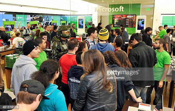 Fans wait to pick up the newly released Xbox One in the Microsoft retail store in the Burlington Mall on November 21 2013 in Burlington Massachusetts...