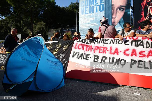 Fans wait while protestors surround the area before 'The Hunger Games Catching Fire' Premiere during 8th Rome Film Festival at the Auditorium Parco...