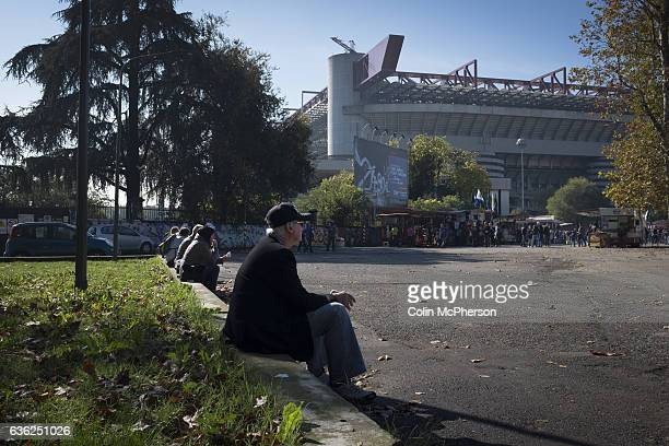 Fans waiting in the sunshine outside the Stadio Giuseppe Meazza also known as the San Siro before Internationale took on Cagliari in an Italian Serie...