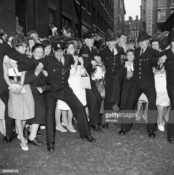 Fans waiting outside the wedding of Tommy Steele and Ann Donoghue at St Patrick's Church Soho Square London 18th June 1960