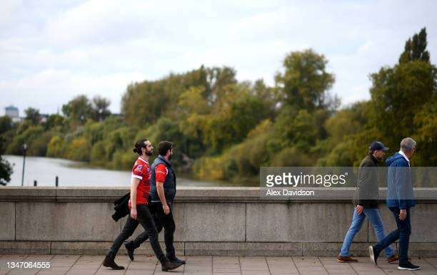 Fans walk across Kew Bridge ahead of the Gallagher Premiership Rugby match between London Irish and Gloucester Rugby at Brentford Community Stadium...
