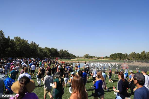 Fans walk alongside the fifth hole during round two of the Abu Dhabi HSBC Golf Championship at Abu Dhabi Golf Club on January 19 2018 in Abu Dhabi...