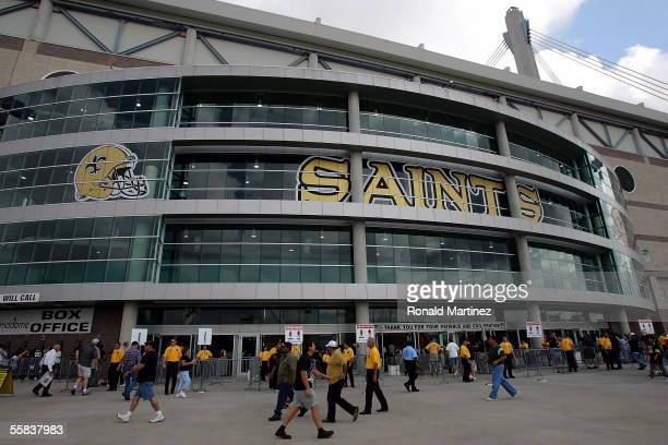 Fans walk around the Alamodome before a game against the Buffalo Bills and the New Orleans Saints on October 2, 2005 in San Antonio, Texas. The...