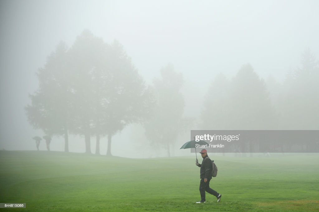 Fans walk around the course sheltering from the rain during Day Three of the 2017 Omega Masters at Crans-sur-Sierre Golf Club on September 9, 2017 in Crans-Montana, Switzerland.
