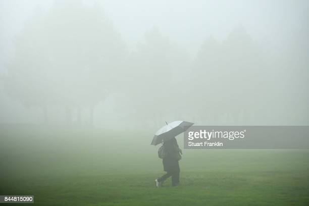 Fans walk around the course sheltering from the rain during Day Three of the 2017 Omega Masters at Crans-sur-Sierre Golf Club on September 9, 2017 in...