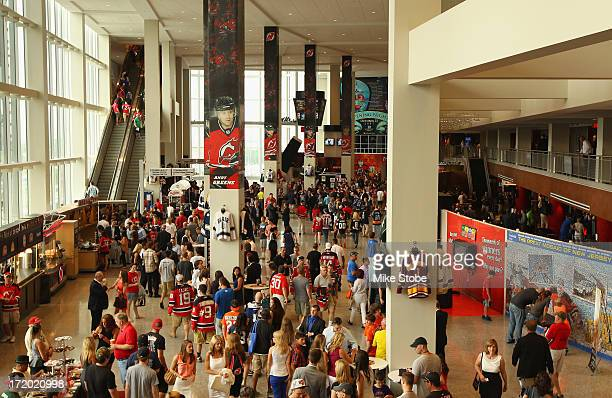 Fans walk around the main concourse of the arena during the 2013 NHL Draft at the Prudential Center on June 30 2013 in Newark New Jersey