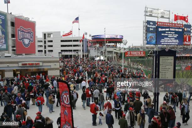 Fans walk around the outfield concourse before the game between the Atlanta Braves and Washington Nationals on Opening Day March 30 2008 at Nationals...