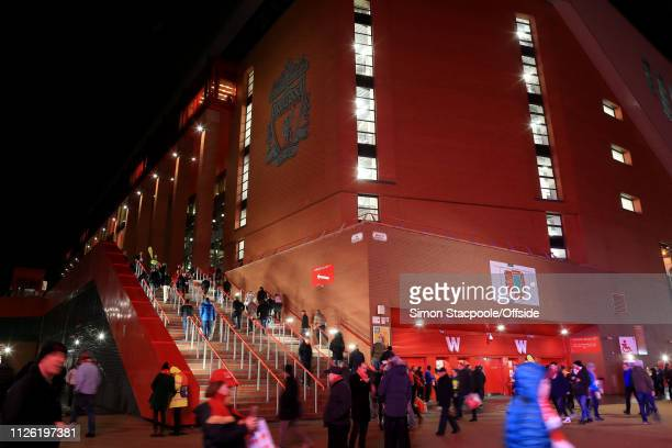 Fans walk around the stadium before the UEFA Champions League Round of 16 First Leg match between Liverpool and FC Bayern Muenchen at Anfield on...