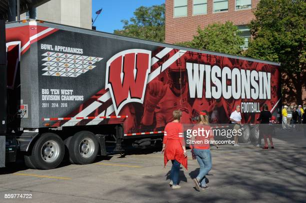 Fans walk by the transport vehicle for the Wisconsin Badgers before the game against the Nebraska Cornhuskers at Memorial Stadium on October 7 2017...