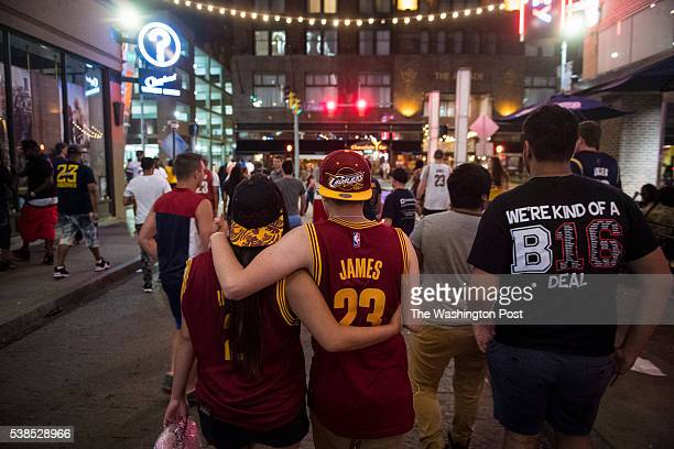 Fans walk down East 4th street after watching the Cleveland Cavaliers one of several professional sports teams based in Cleveland loose the first...