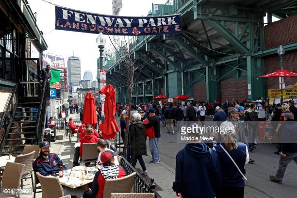Fans walk down Lansdowne Street before the opening day game between the Boston Red Sox and the Pittsburgh Pirates at Fenway Park on April 3 2017 in...