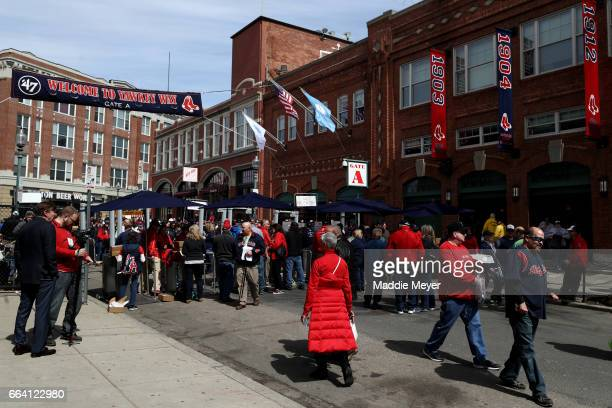Fans walk down Yawkey Way before the opening day game between the Boston Red Sox and the Pittsburgh Pirates at Fenway Park on April 3 2017 in Boston...