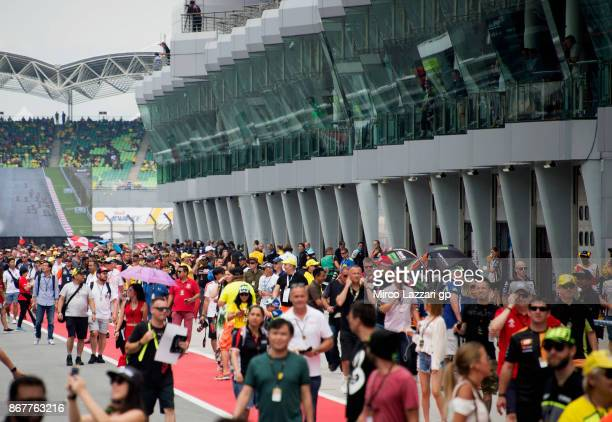 Fans walk in pit during the pit walk before the MotoGP race during the MotoGP Of Malaysia Race at Sepang Circuit on October 29 2017 in Kuala Lumpur...