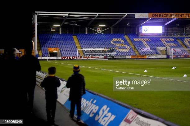 Fans walk inside the stadium prior to the Sky Bet League One match between Shrewsbury Town and Accrington Stanley at Montgomery Waters Meadow on...