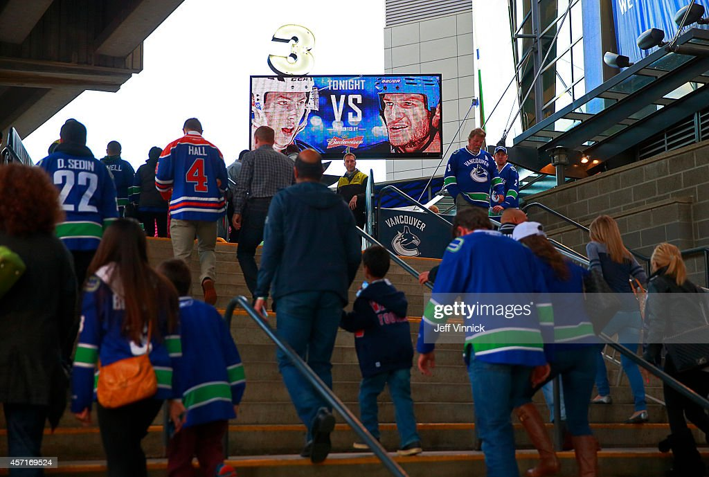 Fans walk into Rogers Arena before the game between the the Vancouver Canucks and the Edmonton Oilers October 11, 2014 in Vancouver, British Columbia, Canada. Vancouver won 5-4 in a shootout.