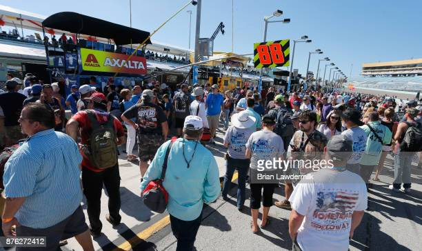 Fans walk on pit road prior to the Monster Energy NASCAR Cup Series Championship Ford EcoBoost 400 at HomesteadMiami Speedway on November 19 2017 in...