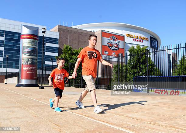 Fans walk outside during Day Two of the 2014 NHL Draft at the Wells Fargo Center on June 28 2014 in Philadelphia Pennsylvania