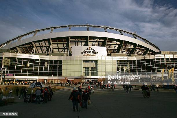Fans walk outside of Invesco Field at Mile High before the AFC Divisional Playoff game between the New England Patriots and the Denver Broncoson...