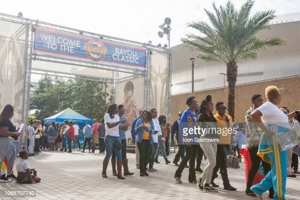 Fans walk outside of the Super Dome prior to the 45th annual State Farm Bayou Classic game between the Southern Jaguars and the Grambling State...