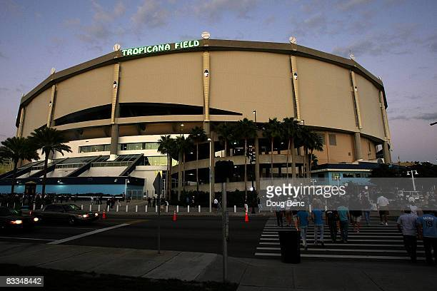 Fans walk outside of Tropicana Field before game seven of the American League Championship Series between the Boston Red Sox and the Tampa Bay Rays...