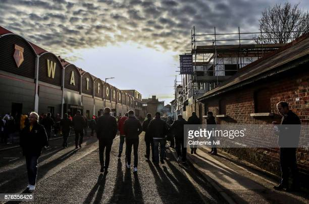 Fans walk outside the stadium before the Premier League match between Watford and West Ham United at Vicarage Road on November 19 2017 in Watford...