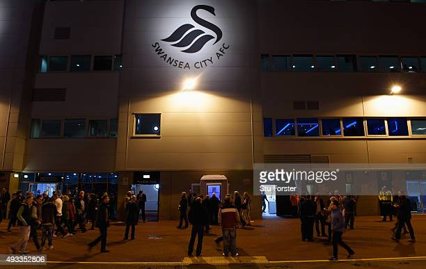 Fans walk outside the stadium prior to the Barclays Premier League match between Swansea City and Stoke City at Liberty Stadium on October 19 2015 in...
