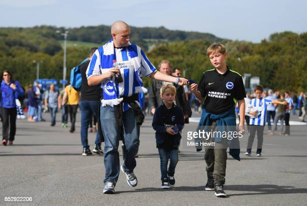 Fans walk outside the stadium prior to the Premier League match between Brighton and Hove Albion and Newcastle United at Amex Stadium on September 24...