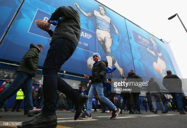Fans walk outside the stadium prior to the Premier League match between Everton FC and AFC Bournemouth at Goodison Park on January 13 2019 in...
