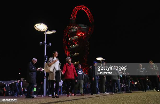 Fans walk outside the stadium prior to the Premier League match between West Ham United and Brighton and Hove Albion at London Stadium on October 20...
