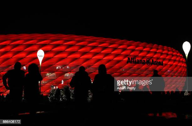 Fans walk outside the stadium prior to the UEFA Champions League group B match between Bayern Muenchen and Paris SaintGermain at Allianz Arena on...