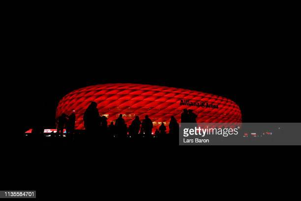 Fans walk outside the stadium prior to the UEFA Champions League Round of 16 Second Leg match between FC Bayern Muenchen and Liverpool at Allianz...