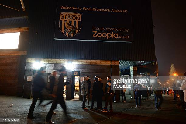 Fans walk past a billboard bearing the Zoopla sponsorship logo at the West Bromwich Albion stadium in West Bromwich on January 20 2014 Zoopla the...