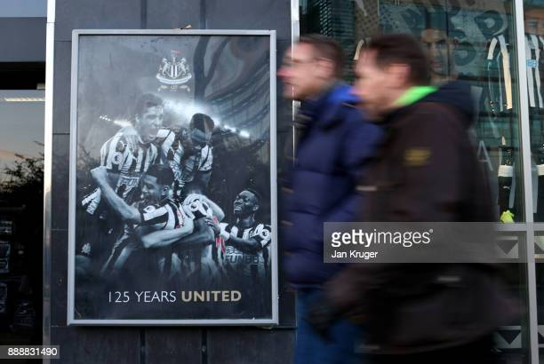 Fans walk past the stadium prior to the Premier League match between Newcastle United and Leicester City at St James Park on December 9 2017 in...