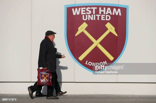 Fans walk past the West Ham crest prior to he Premier League match between West Ham United and Chelsea at London Stadium on December 9 2017 in London...