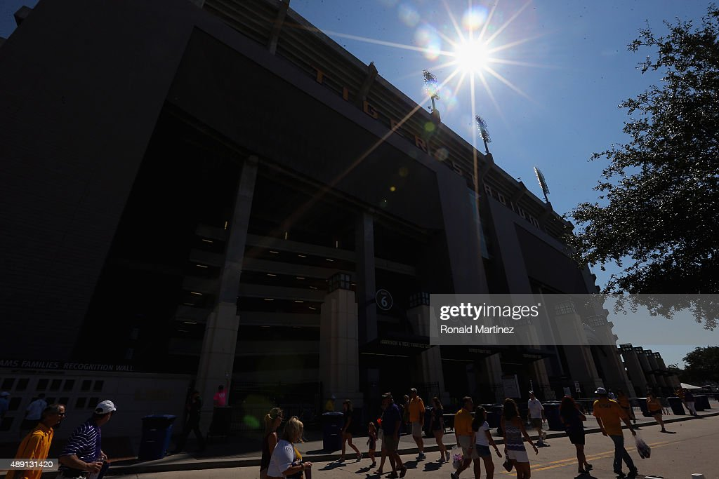 Fans walk past Tiger Stadium before a game between the Auburn Tigers and the LSU Tigers on September 19, 2015 in Baton Rouge, Louisiana.