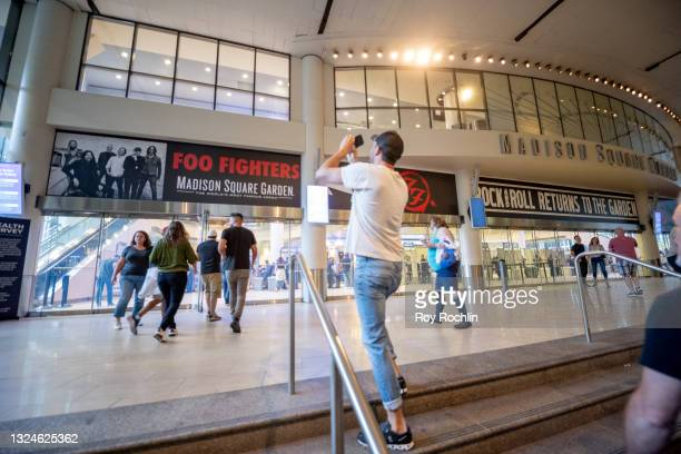 Fans walk takes a photo of the marquee as he walks into the Foo Fighters show as Madison Square Garden reopens with the first full capacity concert...