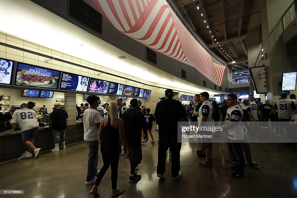 Fans walk the concourse at AT&T Stadium before a game between the Cincinnati Bengals and the Dallas Cowboys on October 9, 2016 in Arlington, Texas.
