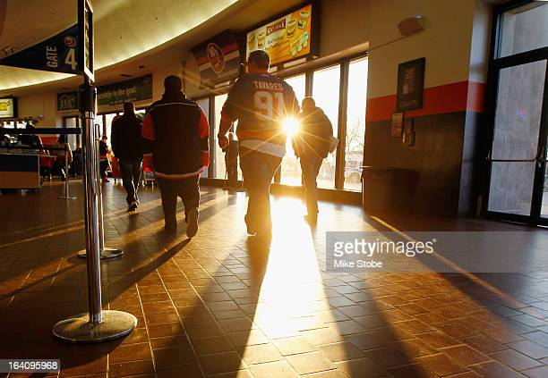 Fans walk the concourse prior to the game between the New York Islanders and the Ottawa Senators at Nassau Veterans Memorial Coliseum on March 19,...