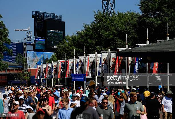 Fans walk the grounds during Day One of the 2016 US Open at the USTA Billie Jean King National Tennis Center on August 29 2016 in the Queens borough...