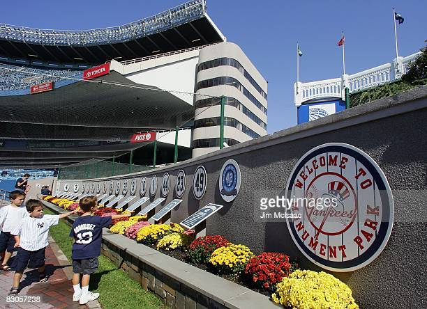 Fans walk through monument park prior to the game between the New York Yankees and the Baltimore Orioles on September 21, 2008 at Yankee Stadium in...