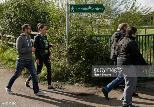 Fans walk to Franklins Gardens before the Aviva Premiership match between Northampton Saints and Leicester Tigers at Franklin's Gardens on September...