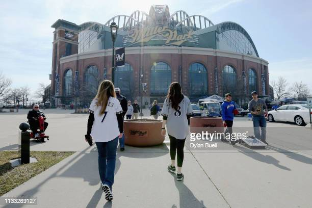 Fans walk to the field before the game between the St. Louis Cardinals and Milwaukee Brewers during Opening Day at Miller Park on March 28, 2019 in...