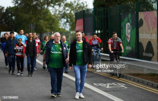 Fans walk to the stadium ahead of the Gallagher Premiership Rugby match between London Irish and Gloucester Rugby at Brentford Community Stadium on...
