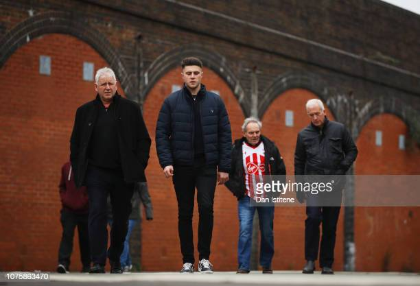 Fans walk to the stadium prior to the Premier League match between Southampton FC and Manchester City at St Mary's Stadium on December 29 2018 in...