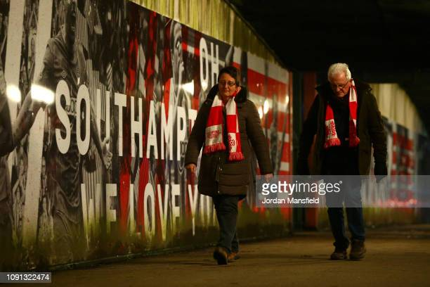 Fans walk to the stadium prior to the Premier League match between Southampton FC and Crystal Palace at St Mary's Stadium on January 30 2019 in...