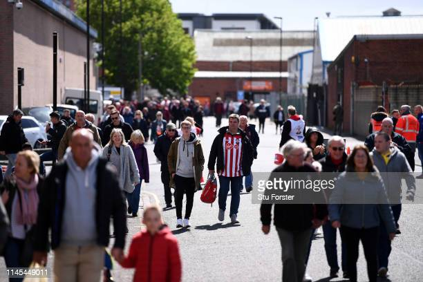 Fans walk to the stadium prior to the Premier League match between Southampton FC and AFC Bournemouth at St Mary's Stadium on April 27 2019 in...