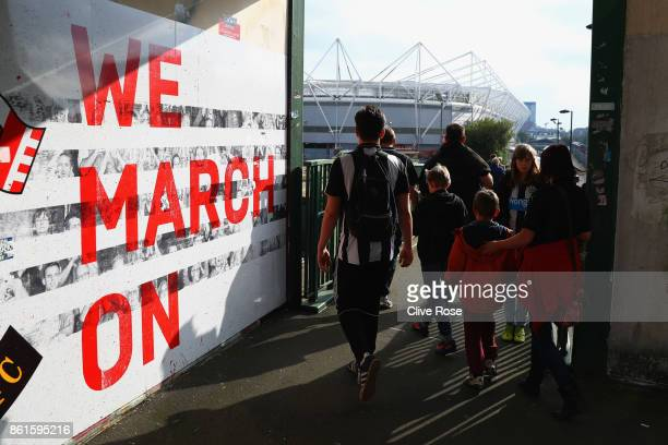 Fans walk to the stadium prior to the Premier League match between Southampton and Newcastle United at St Mary's Stadium on October 15 2017 in...