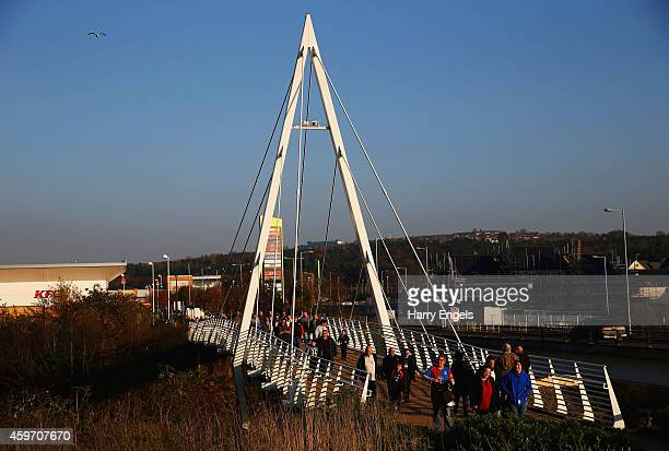 Fans walk tothe ground prior to the Barclays Premier League match between Swansea City and Crystal Palace at Liberty Stadium on November 29 2014 in...